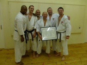 Simon receiving with 6th dan certificate with Adam, Dan White, Darren Jumnoodoo, Terry Oliver and Andy Ramsey.